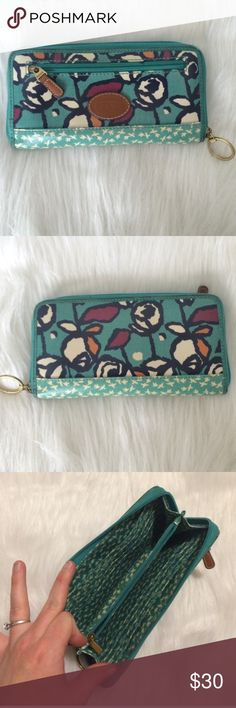 Fossil Wallet Beautiful Fossil wallet with flowers and bird pattern. Holds up to 12 credit cards. In good condition. Last photos shows the small barely noticeable blemishes this wallet has. The corners have some wear from use and the zipper shows a tiny pen stain. Fossil Bags Wallets