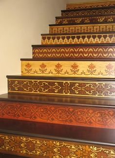 Decorative painting on the risers! (or, for those who don't need to worry about a budget, I would have an expert in marquetry do this.