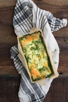 A summery, green zucchini lasagna using a homemade kale-basil pesto for the sauce, raw zucchini and scallions, and whole milk ricotta.