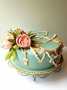 What a stunningly lovely vintage peony and jewelry bedecked cake