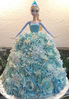 A 6 and an 8 inch chocolate cake with chocolate ganache Elsa doll cake.