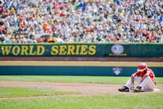 Tijuana, Mexico's Martin Gonzalez sits on first base during a pitching change in the fifth inning of the international championship baseball game against Tokyo, Japan at the Little League World Series tournament, Saturday, Aug. 24, 2013, in South Williamsport, Pa. Tokyo, Japan won 3-2. (Matt Slocum/AP)