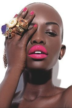 Bright lips, bright nails, and bold jewels