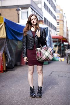 Padded leather jacket and a cross covered dress has Halloween all covered!