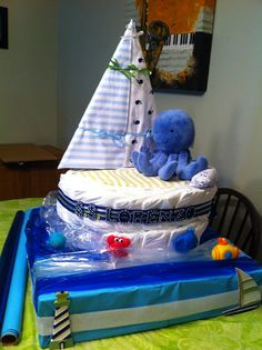 Sail Boat Diaper Cake; see Craftyconjuring on youtube for tutorial. #craftyconjuring