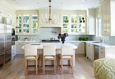 Windows are the back walls of the cabinetry by the range.