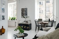 monochrome living room with large windows Beige Living Rooms, Living Room Modern, Home Living Room, Apartment Living, Small Living, Living Spaces, Tiny Apartments, Tiny Spaces, Scandinavian Interior Design