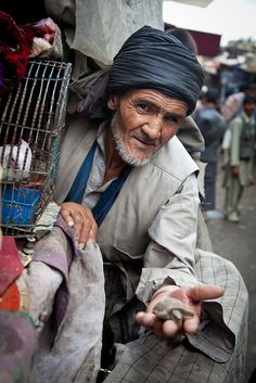Deal in ancient bird market Kabul Afghanistan Asian