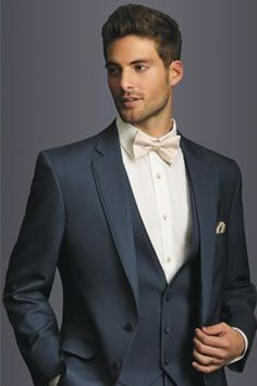 This is the exact suit the groom and groomsmen will be wearing. Just different bowties.