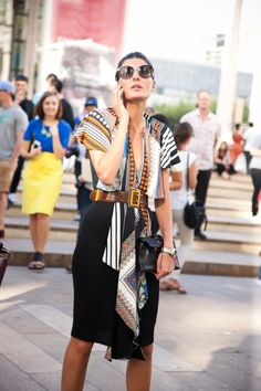 Giovanna Battaglia wearing a printed top with a chic pencil skirt