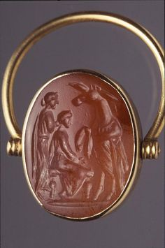 Ring Object Number: 29-128-923Culture:  Roman Provenience:  Mediterranean Period:  Republican Roman Period Section:  Mediterranean Materials:  GoldSardonyx Technique:  Intaglio
