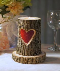 Reclaimed Log Carved Heart Candle Holder Set Looking to add some texture to your space? Whether you live in the county or your home is in the city, you don't have to live in a barn to embrace rustic c