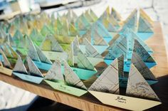I think this map/sailboat is such a neat idea for seating cards. Seeing as so many people are coming from far away.