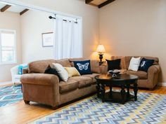 A sectional sofa adds ample seating to this living room. After an investment of $2,675 (plus lots of sweat equity,) the room added $5,600 of value to this home.