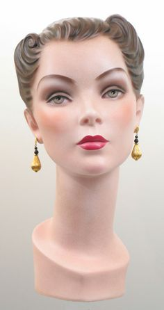 1940s mannequin head.                                                                                                                                                                                 More