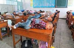 In China teachers allow children to sleep in class for 20 minutes to learn better.