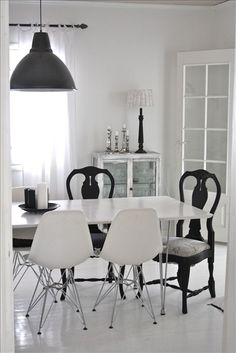 Love the mix of old and modern chairs