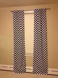 No sew checkered flag curtains! Just used an iron and some stitch witchery! So excited they turned out so well! Also found a tip online to use a new white twin sheet as a liner, and it worked perfectly:) Jakes room is really coming together and he loves it!