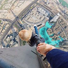Gopro Couple of The Day. No Trust Issues. www.TheGoProZone - Online Shop for Discounted GoPro Gear.com #goprohero #gopro #extreme #extreme #rooftop #skyscraper #couple