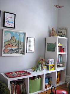 This is the kind of storage I want for the play room...but only tall shelves on both sides.