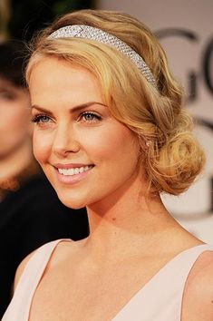 Charlize Theron at the Golden Globes in 2012. Charlize demonstrated the power of a great hair accessory, adding a touch of sparkle to her gorgeous curls with a silver dazzling headband.