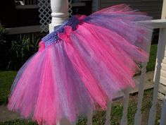 This is truly a crochet band tutu! It's not stretchy so she uses a button closure. Very cute! I may have to try this!