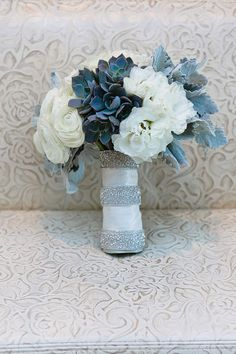 White lisianthus gray dusty miller foliage white ranunculas gray succulents contemporary-bouquet
