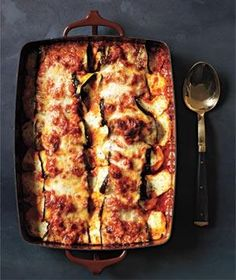 In this pasta-free dish, browned eggplant slices mingle with marinara sauce, ricotta, mozzarella, and Parmesan cheese.