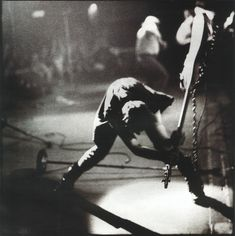 Paul Simonon, from British band The Clash smashes his bass guitar on stage.  Photo by Penny Smith