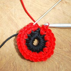Crochet Flowers Ideas 3 - Get those hooks out. here's a free Remembrance Poppy Crochet Pattern. Crochet Puff Flower, Crochet Flower Tutorial, Crochet Flower Patterns, Knitting Patterns, Knitted Poppy Free Pattern, Doll Amigurumi Free Pattern, Knitted Poppies, Knitted Flowers, Crochet Hook Set