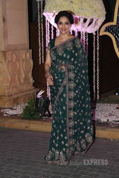 Madhuri Dixit went the sari route in a green Manish Malhotra creation