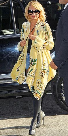 Who made Nicole Richie's yellow jacket, black sunglasses, black leather boots, and purse while in New York?