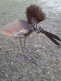 Big Haired Bird bird feeder.  Rusty Relics Metal Art