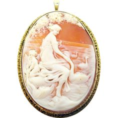 14 Karat Gold Genuine Natural Cameo Pin / Pendant with Figural Scene with Swans. Dates between the 1920s-1940's