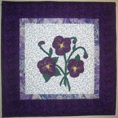 Pansies appliqued wall hanging mini quilt by Serenstitches on Etsy,
