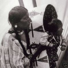 Blackfoot woman and baby (in a Cheyenne beaded cradle Board)