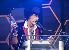 """Perry's thank you speech was short and sweet, including shout-outs to his wife and kids. Actor Johnny Depp, Perry's longtime friend and music partner in crime presented him with the award, humbly admitting that """"Joe Perry is the reason I picked up guitar in the first place.""""  After setting down his trophy, Perry performed a few songs with the help of Depp, fellow Aerosmith guitarist Brad Whitford and Stone Temple Pilots bassist Robert DeLeo. They were joined by shock rocker Alice Cooper…"""