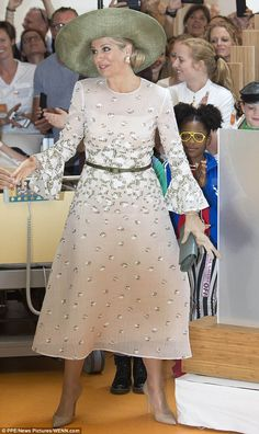 Maxima greeted fans outside the facility as she made her way in, before meeting children a...
