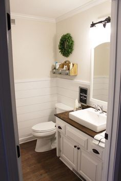 Restroom mirrors are lightly topped with numerous wood textures and tones and wood bath panels are added to step up the style elements as an extension of tradition.
