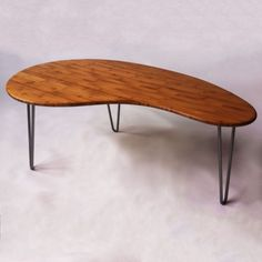Walnut coffee table Three legged with kidney shaped top