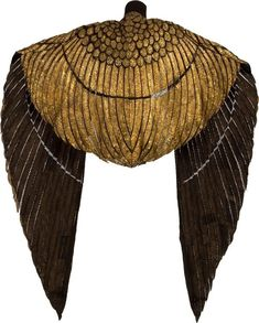 "Rear view of Cleopatra's Phoenix Cape (1963). In 2012 it was auctioned for $59,375. From the auction site's description: ""Crafted to resemble the wings of a Phoenix, ornate piece is made of very thin panels of gold-painted leather adorned with hand-stitched gold bugle beads, seed beads, and bead-anchored sequins, visible areas of mesh lining offset each beaded panel, two hidden hook-and-eye closures sewn along the front. Cape's Wingspan: 124"" with 62"" from the center seam to each tip."""