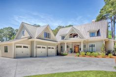Farmhouse Style House Plan - 4 Beds 4.5 Baths 3238 Sq/Ft Plan #928-10 Exterior - Front Elevation - Houseplans.com