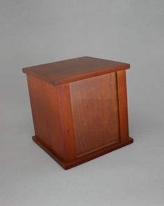 Small photo cremation urn for ashes. This is a solid timber wooden urn. (http://www.casketsdirect.com.au/products/cremation-urns-photo-cube-urn.html)