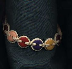 Button Bracelet  I think this could also be made into a belt.  Large bags of buttons sold at JoAnn's and Michaels