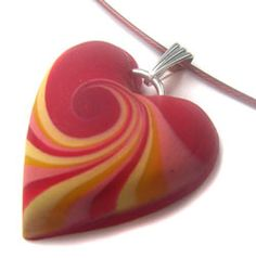 Louise Fischer Cozzi sells translucent, thin, minimalist pendants that benefit the Heart Association on her Etsy site. The edges are carefully painted gold. Easy? Yes. Classy? Certainly. Follow your heart | Polymer Clay Daily