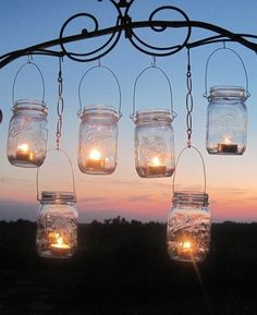 I see these hanging from your trees, near the hammock...its such a great idea and very low cost, just some mason jars, chain from home depot, and tea lights, you could even paint the glass, with glass paint!!!