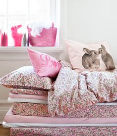 Pink neon rabbit lamp. Bunny bedding. Princess & the Pea bed. Girls room.