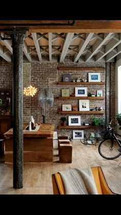 Modern brick loft....love the shelves, would be cooler if every other shelf was off-center