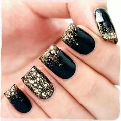 black nails with gold glitter