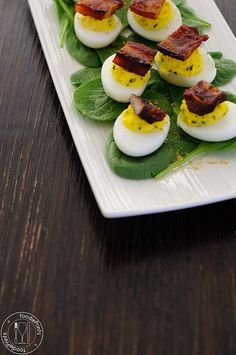 Korean-Inspired Deviled Eggs  That's gochujang-roasted pork belly...and there's Japanese mayo in the yolks...